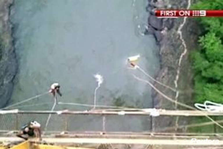 <p>Erin Langworthy makes a splash as she plummets into the Zambezi River after her bungee cord breaks during her jump in Victoria Falls. Image grabbed from video footage taken at the scene.</p>