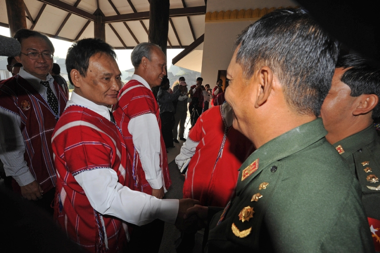 <p>Representative of the rebel Karen National Union (KNU) Saw Jawni (Johnny, on left) shakes hands with an official following cease-fire talks with a Burma government delegation in Pa-an, the main city of the country's eastern Karen state.</p>