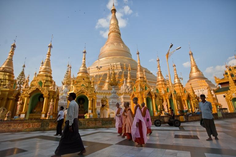<p>People visit the Shwedagon Paya on December 05, 2010 in Yangon, Burma.</p>