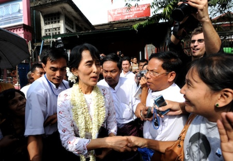 <p>Myanmar democracy icon Aung San Suu Kyi greets supporters after her press conference on the anniversary of her release at the National League for Democracy (NLD) headquarters in Yangon on November 14, Myanmar.</p>