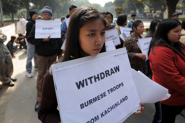 <p>Activists of the Kachin National Organisation and Burmese protestors living in exile in India hold placards during a protest.  AFP PHOTO/ MANAN VATSYAYANA</p>