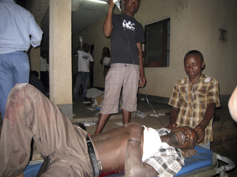 <p>A victim of armed raiders, who killed at least 36 people on September 18 when they stormed a Burundi bar and opened fire on patrons, is tended to at the Prince Regent Charles Hospital in Bujumbura on September 19, 2011. The attackers raided a bar in Gatumba area, some eight miles west of the capital Bujumbura, which lies in a stronghold of the former National Liberation Forces rebels whose leader Agathon Rwasa has been blamed for a recent spate of attacks.</p>