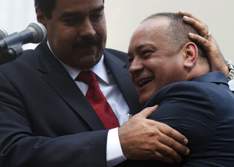 <p>Venezuelan Vice-President Nicolas Maduro (L) embraces the president of the Venezuelan National Assembly, Diosdado Cabello, outside the National Assembly in Caracas on January 5, 2013. Venezuelan lawmakers gathered Saturday for a key leadership vote and debate as President Hugo Chavez's battle with cancer appeared almost certain to delay his swearing-in for a new six year term.</p>