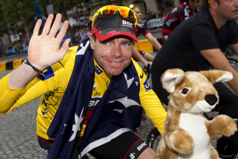 <p>Yellow jersey of overall leader, Australia's Cadel Evans waves holding a kangaroo soft toy during the parade on the famous Champs-Elysees avenue in Paris, after he won the 2011 Tour de France cycling race on July 24, 2011.</p>