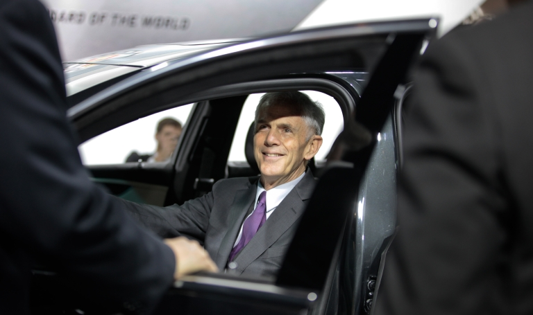 <p>US Commerce Secretary John Bryson sits in the Cadillac XTS during his tour of the North American International Auto Show in Detroit, Mich., on Jan. 10, 2012.</p>