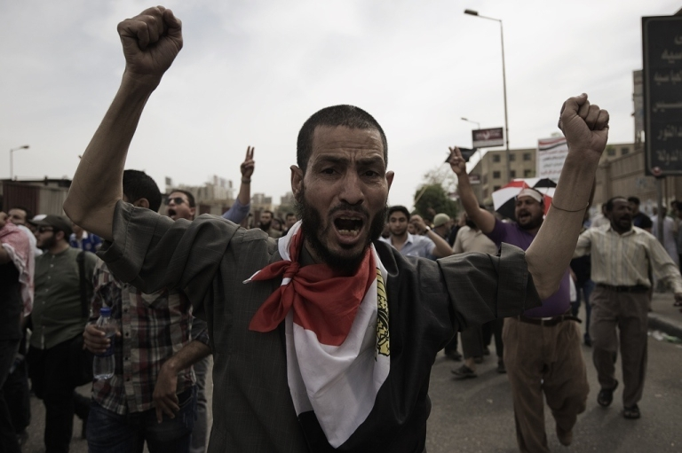 <p>Egyptian protesters shout slogans at soldiers outside the defense ministry on May 4, 2012 in Cairo.</p>