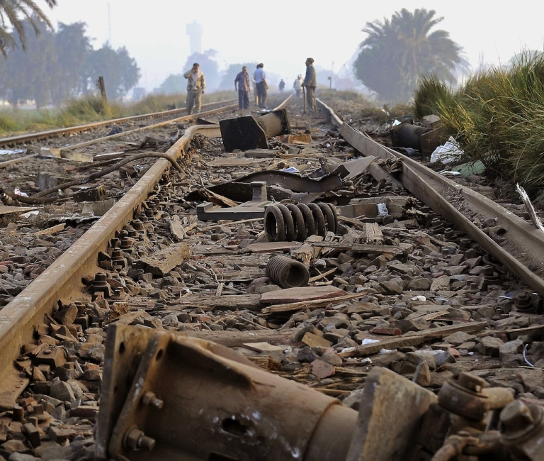 <p>Egyptians clear debris from the tracks on October 25, 2009, hours after a collision between two passenger trains in the Al-Ayyat area of Giza, 40kms (25 miles) southwest of Cairo.</p>