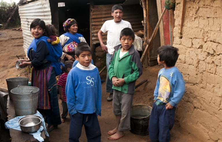 <p>Isabella Hernandez and her children stand outside their home high in the mountains in Cajola, Guatemala. Hernandez, 37, is a single mother who must support her children on less than $1 a day.</p>