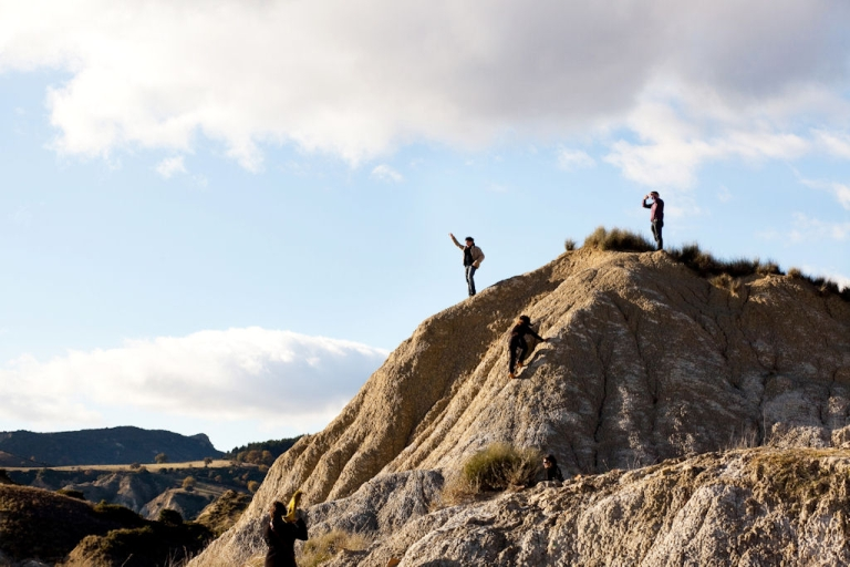 <p>Tourists hike in the calanchi district near the town of Aliano. Locals worry that oil exploration and a proposed biomass site pose health risks and endanger the fragile environment.</p>