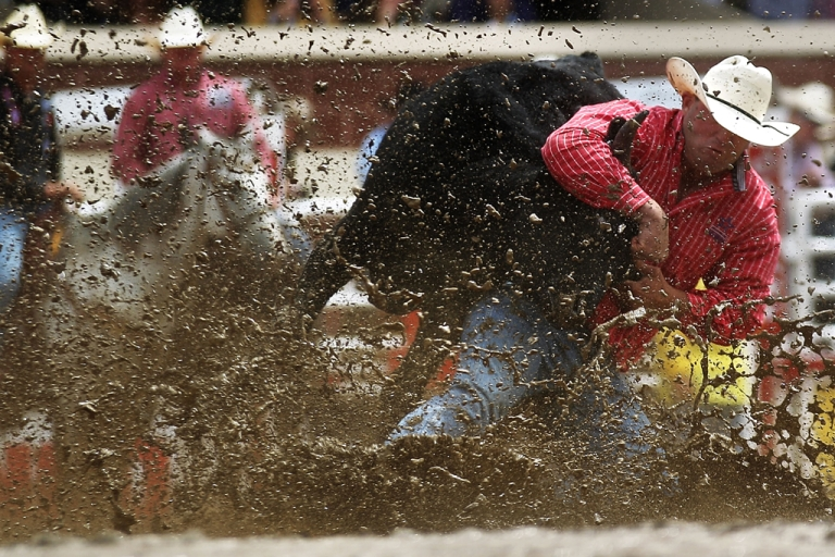<p>Jule Hazen competes in steer wrestling at the Calgary Stampede rodeo on July 11, 2011, in Alberta, Canada. The 10-day event is billed as the 'Greatest Outdoor Show on Earth.'</p>
