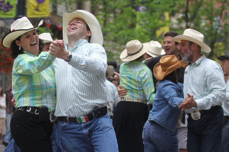 <p>Revelers square dance during the Calgary Stampede on July 11, 2011, in Calgary, Alberta, Canada. The 10-day event, drawing over 1 million visitors, is Canada's largest annual rodeo and is billed as the Greatest Outdoor Show on Earth.</p>