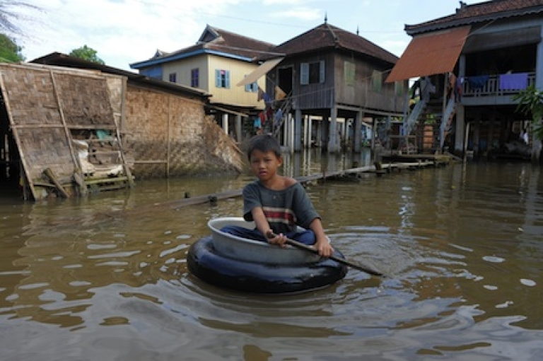 <p>A Cambodian boy rows through floodwaters at a village 20 kilometers east of Phnom Penh on October 25, 2011. Over 700 people have been killed and eight million affected by heavy flooding across Southeast Asia, the United Nations said on October 18, adding that it stood ready to provide humanitarian relief. Torrential rains have pelted Thailand, Cambodia, Laos and Vietnam, cutting off roads and destroying homes and crops.</p>