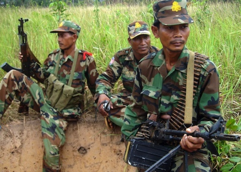 <p>Cambodian soldiers stand guard near the Thai-Cambodia border in Oddar Meanchey province on May 1, 2011.</p>
