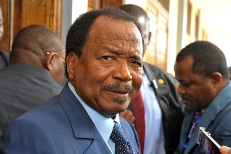 <p>Cameroon's President Paul Biya addresses the media after casting his vote for president at the Bastos bilingual school, one of Yaounde's voting stations, on Oct. 9, 2011.  Biya was sworn in for his sixth term as president in November.</p>