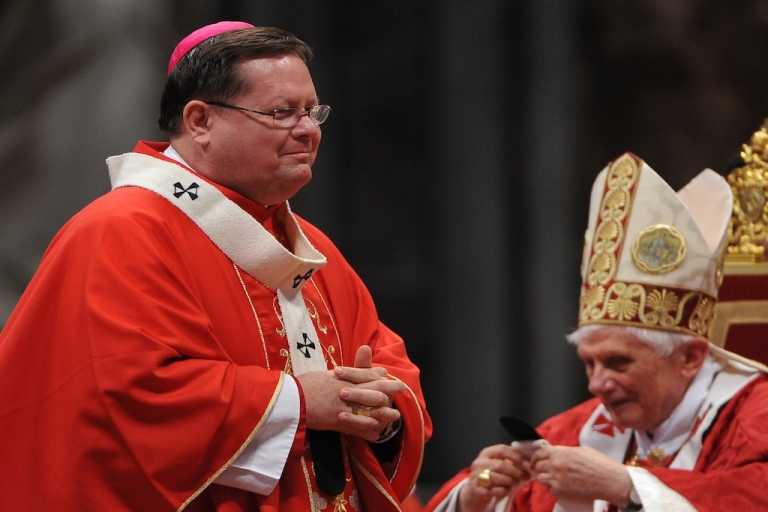 <p>Canada's Archbishop of Quebec Gerard Cyprien Lacroix (L) receives the Pallium from Pope Benedict XVI during the solemn mass at St. Peter's basilica to celebrate the feast of Saint Peter and Saint Paul on June 29, 2011 at The Vatican.</p>