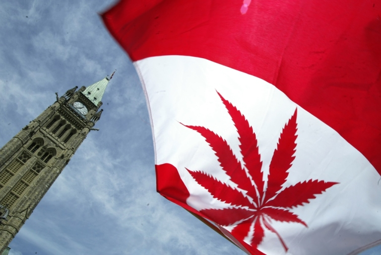 <p>A Canadian flag with a marijuana leaf alongside Parliament Hill in Ottawa, on June 5, 2004.</p>