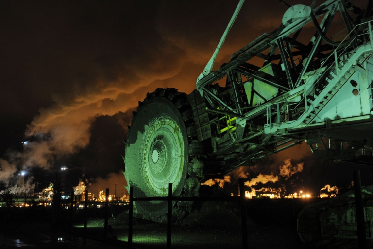 <p>Mining equipment sits unused in front of the Syncrude oil sands extraction facility near Fort McMurray, Alta. The oil sands are seen as a major driver to Canada's economy despite claims extraction poisons the rivers and air in northern Canada.</p>
