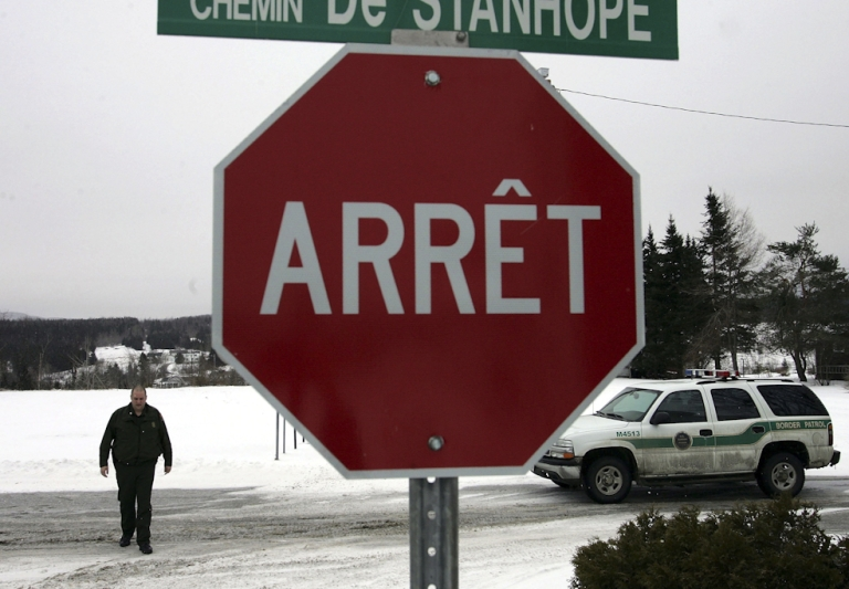 <p>A border patrol agent walks on the Canadian/United States border. Thirty fugitives wanted for war crimes or crimes against humanity are believed to be hiding in Canada, Prime Minister Stephen Harper's government has said, and Canada's Border Services Agency is appealing for the public's help to find them.</p>
