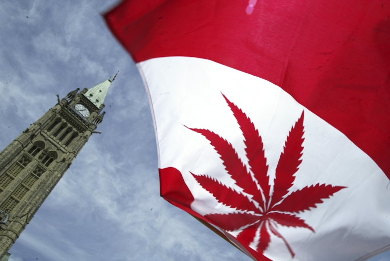 <p>A Canadian flag with a marijuana leaf flies during a rally in support of legalizing marijuana on Parliament Hill in Ottawa, Canada.</p>