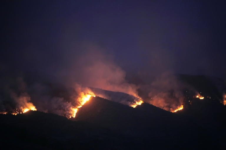 <p>Smoke rises from wild fires raging on the Spanish Canary Island of Tenerife. Some 4,700 residents of the Canary Islands have been evacuated as wild fires continue to rage.</p>