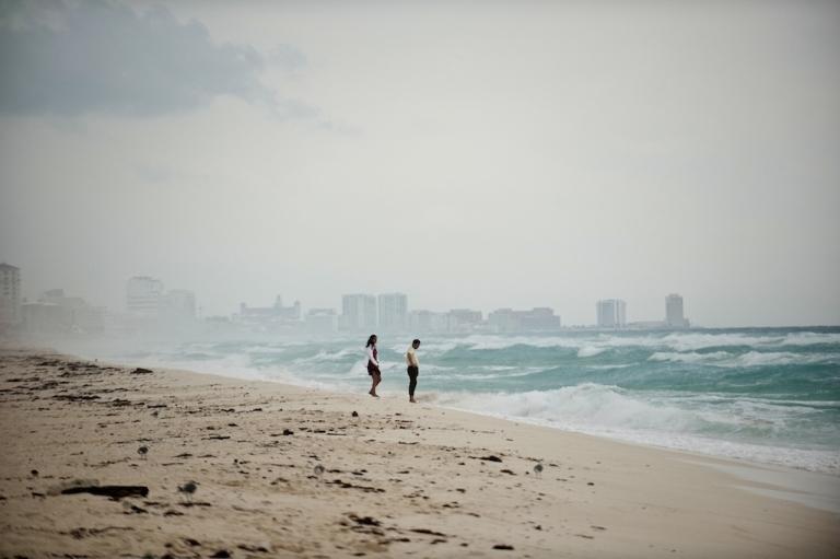 <p>A couple walks along Playa del Carmen beach near Cancun on October 25, 2011.</p>