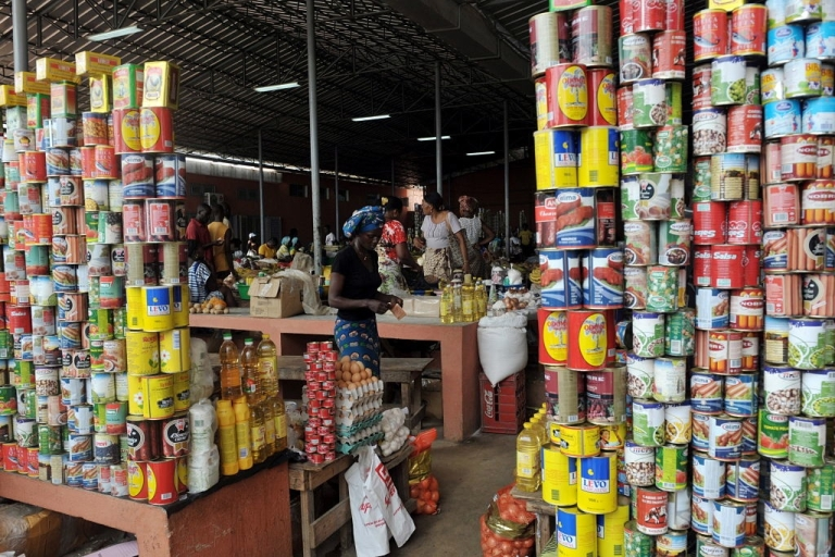 <p>Canned food are piled up in a market in Cabinda on January 19, 2010.</p>
