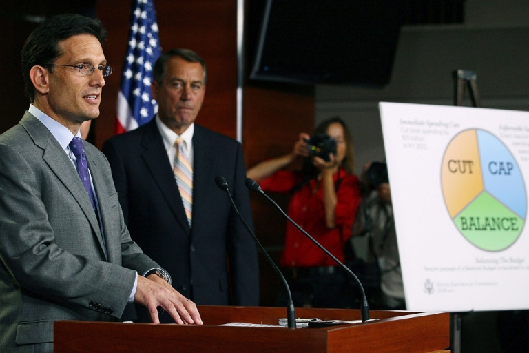 <p>WASHINGTON, DC - Majority Leader Eric Cantor (R-VA), speaks while flanked by House Speaker John Boehner (R-OH) at the U.S. Capitol, on July 19, 2011. House Republicans introduced a cut, cap and balance, plan would raise the debt ceiling $2.4 trillion, but only after significant spending cuts, and a constitutional amendment requiring a balanced federal budget.</p>