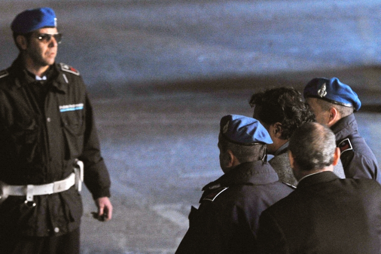 <p>The Italian captain of the stricken cruise ship Costa Concordia, Francesco Schettino (C), is escorted by police after being questioned by prosecutors in the Grosseto court on January 17, 2012.</p>