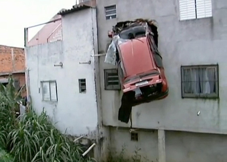<p>A car flew off a São Paulo, Brazil, road on April 15, 2012, and got stuck in the second-story wall of a house.</p>