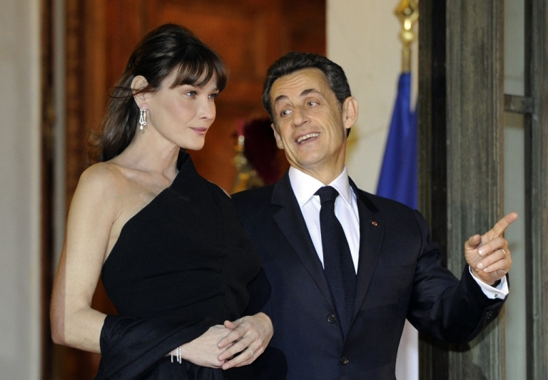 <p>French President Nicolas Sarkozy and his wife Carla Bruni-Sarkozy wait for South African President Jacob Zuma as he arrives at the Elysee Palace to take part in an official dinner, on March 2, 2011 in Paris.</p>