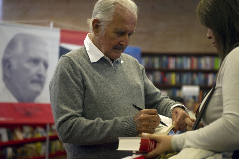 <p>Carlos Fuentes signs a book in Bogota on February 1, 2012.</p>