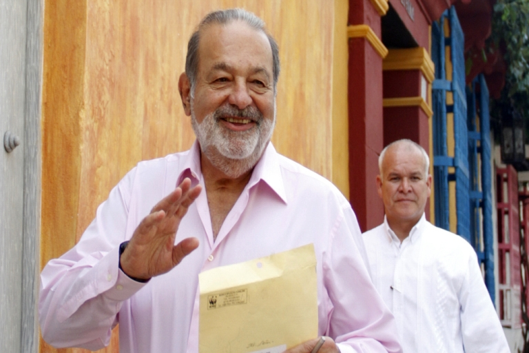 <p>Mexican billionaire Carlos Slim (L) walks in a street of Cartagena de Indias, Colombia, on October 26, 2012. Slim is the World's richest man and has benefited from the left-wing governments of Latin American nations.</p>