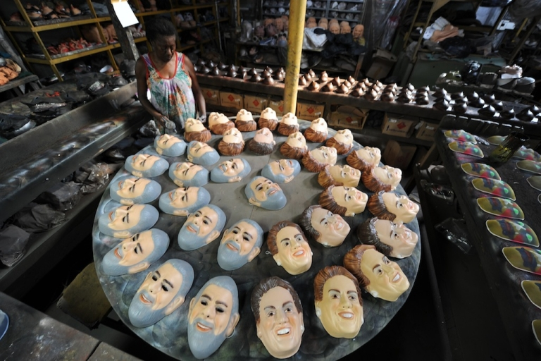 <p>A worker gives the final touches to masks of President Dilma Rousseff and former-President Luiz Inácio Lula da Silva at Condal Carnival Masks Factory in São Gonçalo, 35 km from downtown Rio de Janeiro, Brazil, on February 3, 2012.</p>