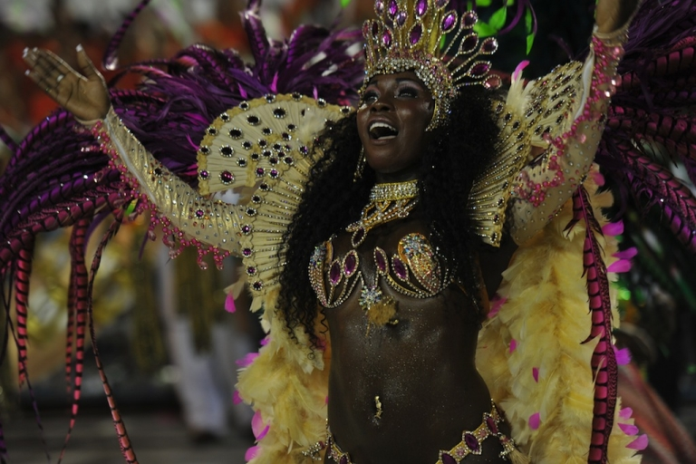 <p>A reveller of Mangueira samba school performs during the second night of Carnival parades at the Sambódromo in Rio de Janeiro, early on February 21, 2012.</p>