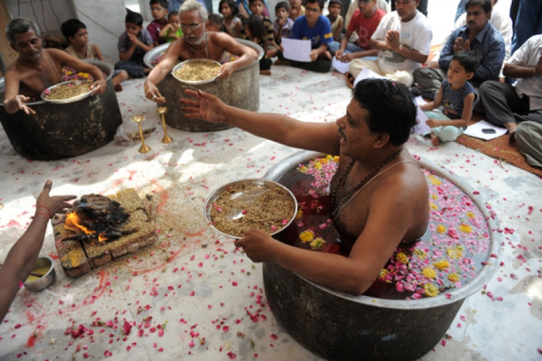 <p>Indian Hindu Brahmins perform a 'Parjanya Yagna' ritual to appease the 'rain gods' at The Shree Paanchnath Mahadev Temple in Ahmedabad on June 26, 2011. Two new studies have shed some light on the role of caste and religion in income inequality. Not surprisingly, Brahmins, the highest caste, enjoy a disproportionate share of the country's wealth.</p>