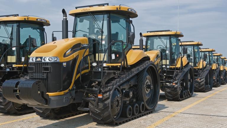 <p>Caterpillar 2009 Challenger MT765C farm tractors sit on on the docks of the Port of Baltimore's Dundalk Terminal in Baltimore, Md., waiting to be loaded onto ships for export, on Aug. 27, 2009.</p>