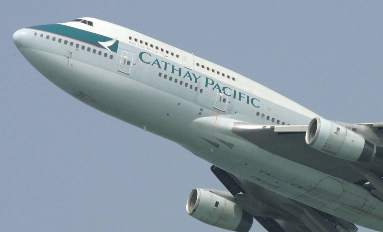<p>A Cathay Pacific passenger jet takes off from Hong Kong. The airline sacked a pilot and a flight attendant after photographs of them havig oral sex in a cockpit appeared online.</p>