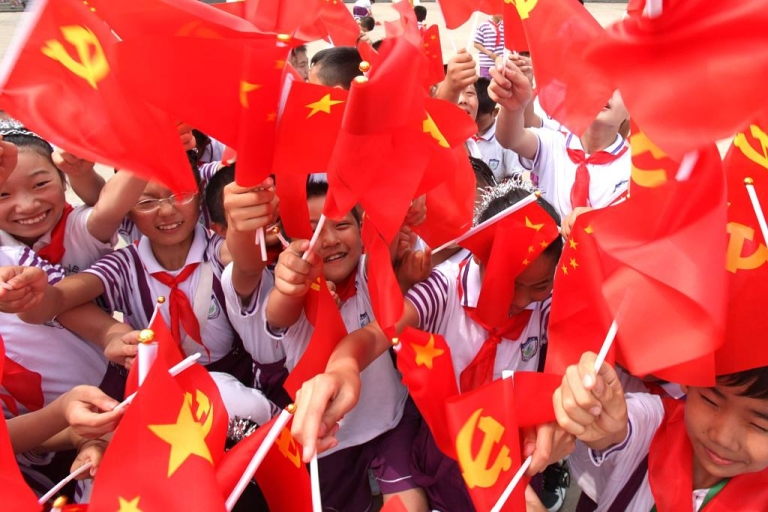 <p>Students at Yuanqian Primaray School in Jiangsu Province wave Chinese Communist Party flags on June 30, 2011.</p>