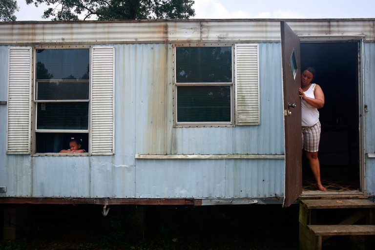 <p>Christy Sibley (R) and daughter Rosheka stand in their trailer May 5, 2009 in Fluker, Louisiana. The highly impoverished rural town has very few jobs and no mayor. The recession has hit many Americans hard, but the rural Lower Mississippi Delta region has had some of the nation's worst poverty for decades.</p>