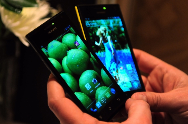 <p>The Huawei Ascend P1 S mobile phone (L) is displayed during Press Day Events at the annual Consumer Electronics Show on Jan. 9, 2012 in Las Vegas, Nevada.</p>