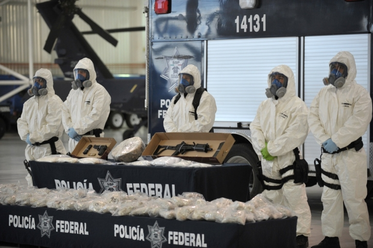 <p>Mexican police on Feb. 14 show the press drugs and weapons seized from alleged members of the Pacific drug cartel run by Joaquin