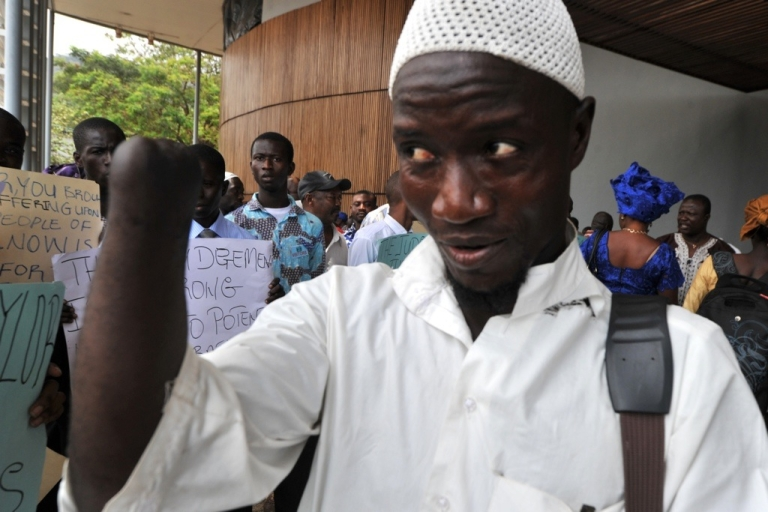 <p>In Freetown, Sierra Leone, Mohamed Traore, one of the amputees of the civil war, welcomes the conviction on war crimes of former Liberian President Charles Taylor. Taylor was found guilty of arming rebels during Sierra Leone's civil war in return for blood diamonds.</p>