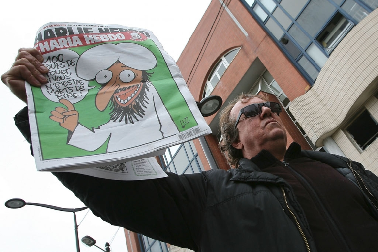 <p>A man shows the French satirical magazine