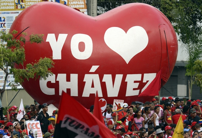 <p>Supporters of Venezuelan President Hugo Chavez attend a massive rally after he registered his candidacy for the upcoming presidential election.</p>