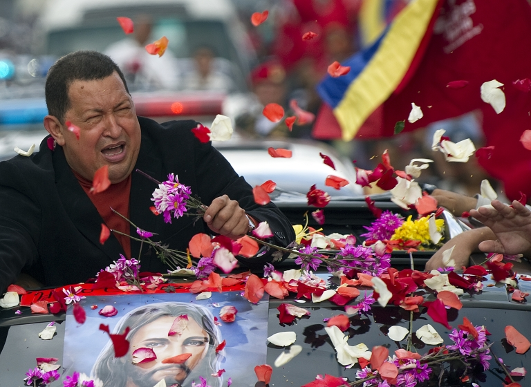 <p>Venezuelan President Hugo Chávez is greeted on Friday by supporters in Caracas as he makes his way to the airport to travel to Cuba.</p>