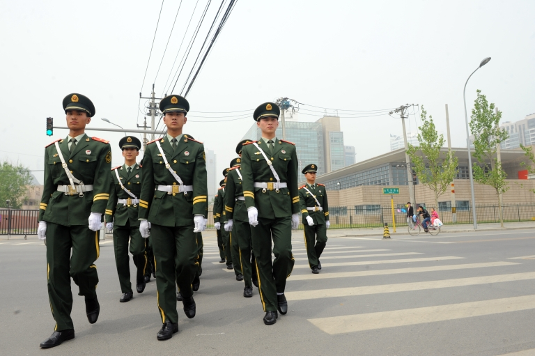 <p>Chinese paramilitary guards march from the US embassy in Beijing on April 30, 2012. Chinese rights activist Chen Guangcheng is in the US embassy in Beijing but is not seeking asylum, fellow dissident Hu Jia said raising the spectre of a drawn-out China-US diplomatic standoff.</p>