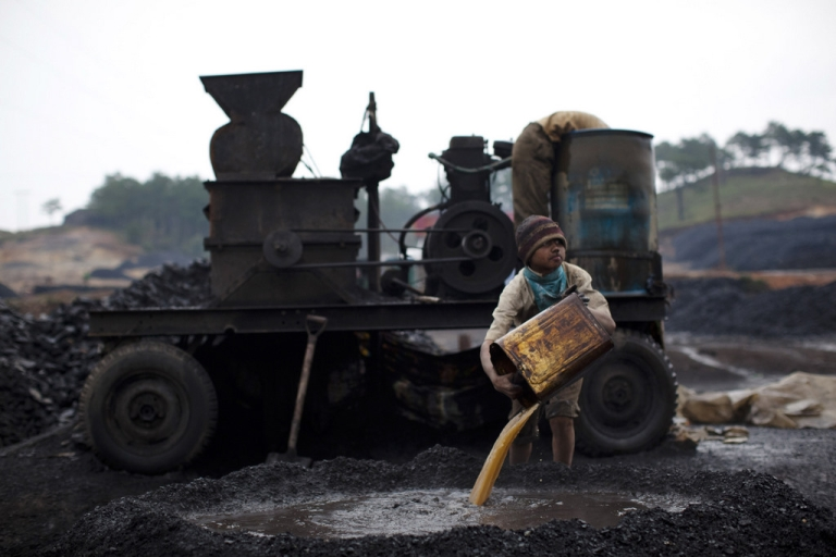 <p>JAINTIA HILLS, INDIA - APRIL 16:  A boy works at a coal depot on April 16, 2011 near to Lad Rymbai, in the district of Jaintia Hills, India.</p>