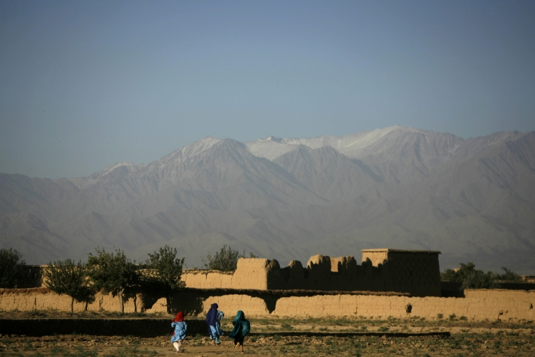 <p>Children playing in the shadow of the Hindu Kush mountain range, in a scene that could be from today or a century ago.</p>