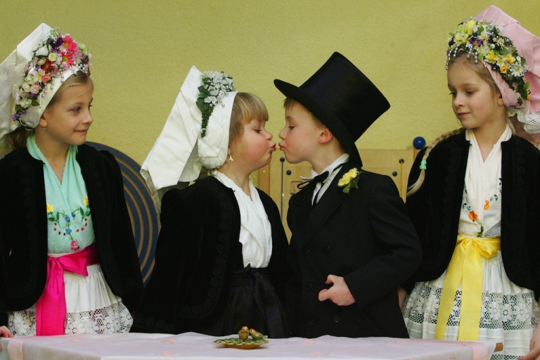 <p>Child 'groom' Maurice (2nd from R) kisses his 'bride' Lenka during a traditional Sorbian 'birds wedding' at a kindergarten in Cottbus, eastern Germany. Children of Sorbian origin traditionally celebrate the symbolic wedding to greet the upcoming end of the winter. The Sorbs are a small west Slavic people, living as a minority in the German states of Saxony and Brandenburg.</p>