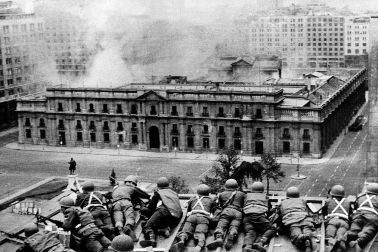 <p>Chilean Army troops fire on the La Moneda Palace on Sept. 11, 1973.</p>